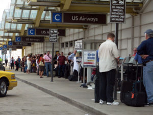 Long line to check in outside Terminal C at Regan National Airport, which has been hit by a power outage