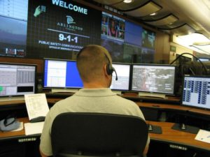 A 911 dispatcher in Arlington's Emergency Communications Center