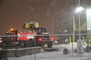 Road salt being loaded onto a salt truck at the VDOT facility on Columbia Pike