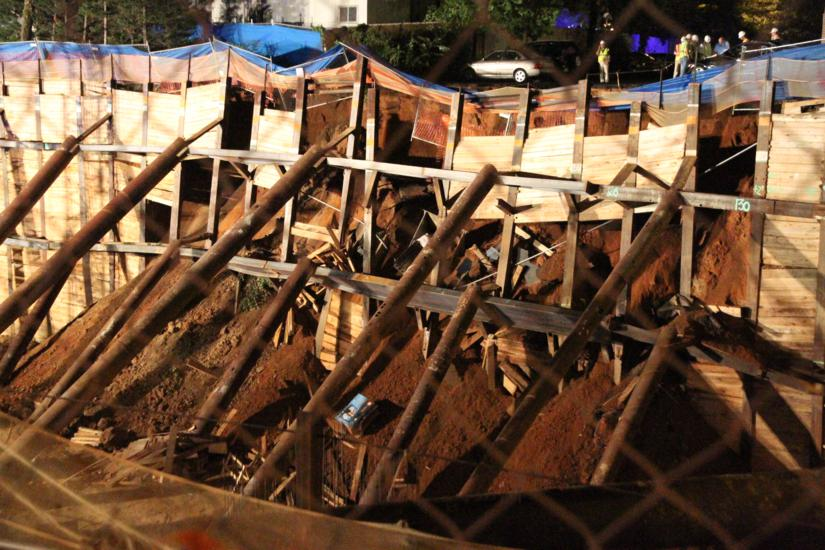 collapse at construction site threatens nearby apartments