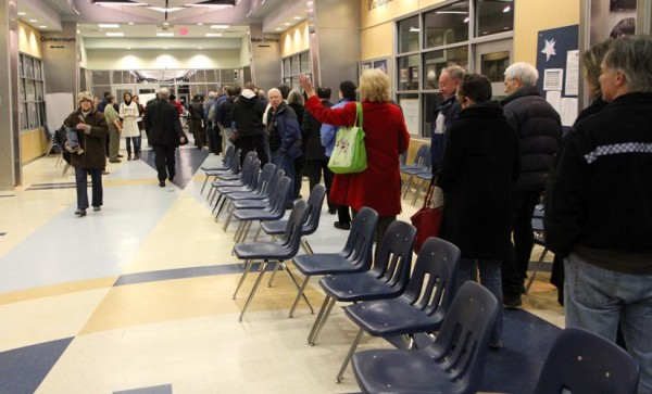 Voters line up at the Democratic caucus at Washington-Lee High School (Jan. 2012)