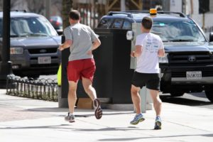 Men running in Clarendon