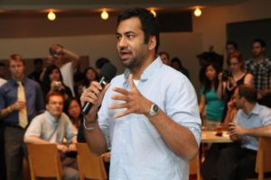 Actor Kal Penn and former White House official Aneesh Chopra talk with Obama supporters in Arlington