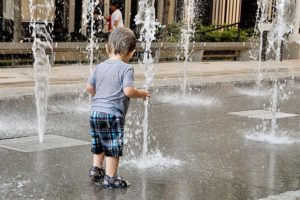 Child cooling off at fountains in Ballston (photo by Maryva2)