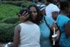 A candlelight vigil was held in the Hall's Hill community for homicide victims Keefe Spriggs and Carl Moten