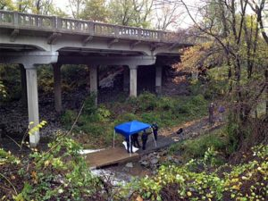 Police investigate a likely suicide on the Four Mile Run Trail under Columbia Pike (photo courtesy Devin L.)