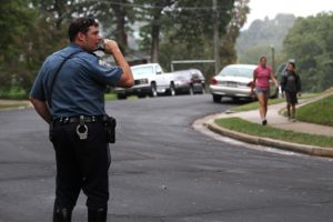 A police officer keeps watch during Walk and Bike to School Day 2012 at Oakridge Elementary School