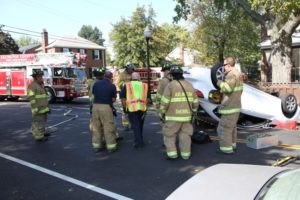 A car flipped on its roof near Patrick Henry Elementary School