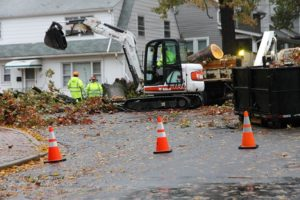 Workers remove fallen tree from Washington Blvd at N. Utah Street