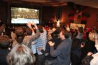 Democrats celebrating election returns at the Arlington Cinema Drafthouse