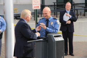 Neal Nichols hands vehicle keys to Chief Scott