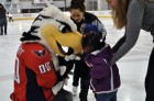 Washington Capitals mascot Slapshot greets children on the ice at Kettler Capitals Iceplex during Monumental Sports & Entertainment's Family-to-Family holiday party