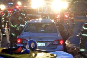 Firefighters work to extricate the driver of a vehicle involved in a critical accident on Glebe Road (photo courtesy @CAPT258)
