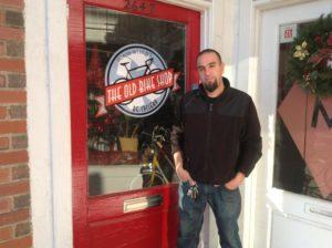 Owner Larry Behery outside The Old Bike Shop in Lyon Park