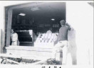 Installation of new window at Green Valley Pharmacy (photo from 1958, via Arlington County website)