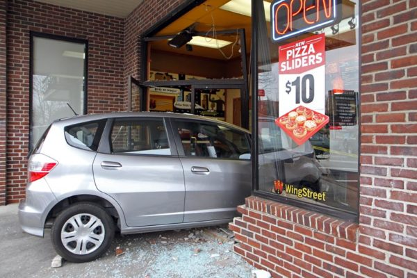 breaking car plows into pizza hut. Black Bedroom Furniture Sets. Home Design Ideas