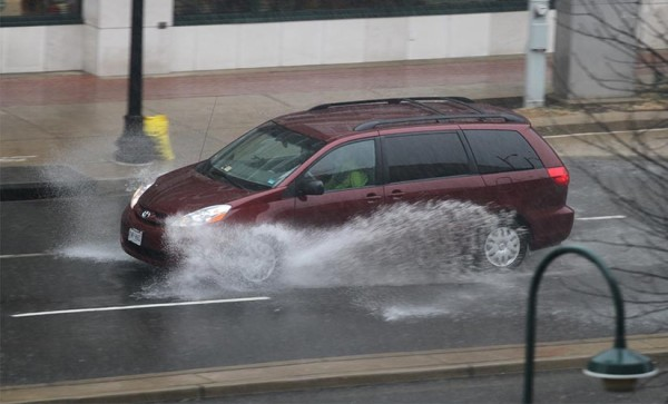 Car drives through standing water in Pentagon City