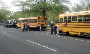 An SUV ran into two parked school buses on S. Hayes Street on 4/19/13