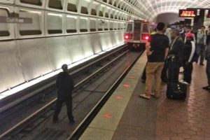 Man on the track at the Courthouse Metro station (photo via @mikekap3)