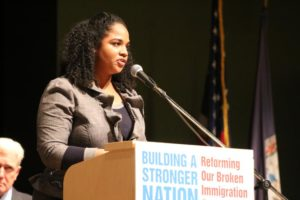 Gabrielle Jackson, speaking at a panel discussion on immigration at Kenmore Middle School