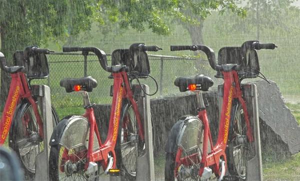 Capital Bikeshare in the rain by Wolfkann