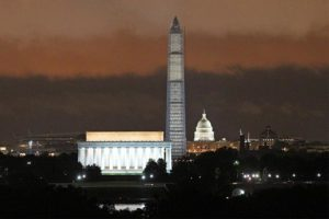 Night view of the Lincoln Memorial, Washington Monument and Capitol from Arlington