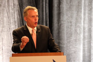 Terry McAuliffe speaks in front of Arlington Democrats