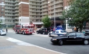 Police and firefighters on scene of a woman who fell from Randolph Towers in Ballston (photo courtesy @zippychance)