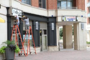 Signs changing from Melody Tavern to Crystal City Children's Center