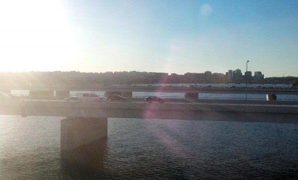 Sunset over Rosslyn and the Potomac River, as seen from a Yellow Line Metro train