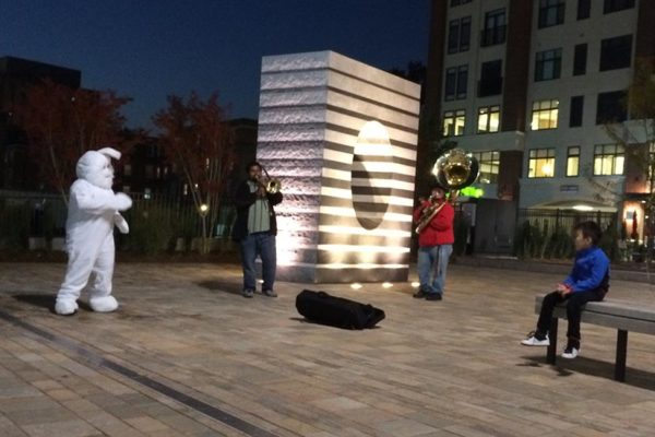 An impromptu tuba and trombone concert at Penrose Square Wednesday night