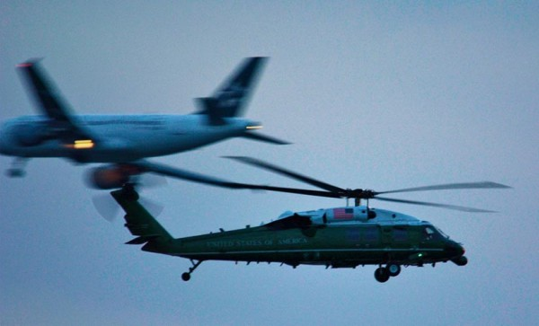 A VH-60 helicopter and passenger jet landing at DCA photographed in flight (Flickr pool photo by J. Sonder)