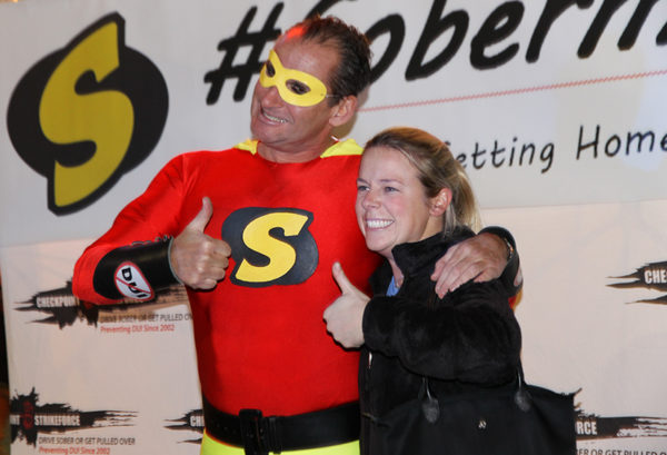 SoberMan, SoberWoman's other half, poses with an unidentified woman in Clarendon