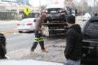 A crash between a tow truck, taxi and county truck on George Mason Drive