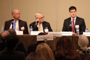 Arlington Economic Development's Alex Iams, left, speaks at the NAIOP economic development luncheon