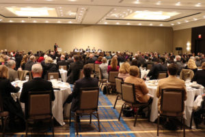 The commercial real estate industry in Northern Virginia listens to economic development officials speak