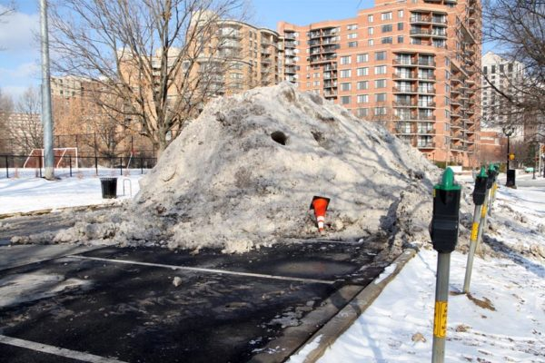 Large snow pile in the parking lot for Virginia Highlands Park