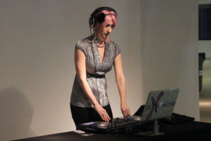 A DJ performs for the networkers