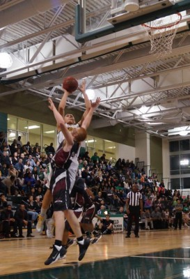 Dominique Tham shoots over a Mt Vernon defender