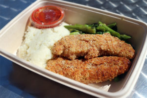 Almond-crusted chicken tenders and cauliflower mash from the Green Spoon
