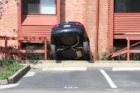 A 70-year-old woman in a Hyundai crashed into a condo building on S. George Mason Drive
