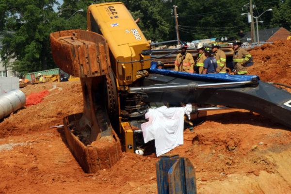 Breaking worker dies after excavator tips over for Construction tips