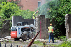 Workers tear down part of The W&OD trestle in East Falls Church