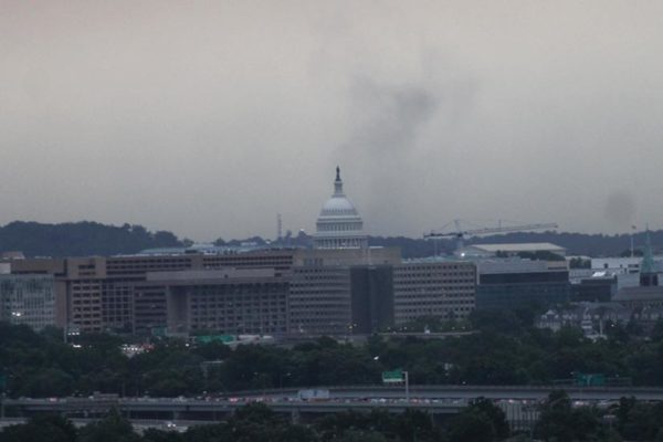 A low cloud can be seen in motion behind the Capitol while storms blow through the D.C. area