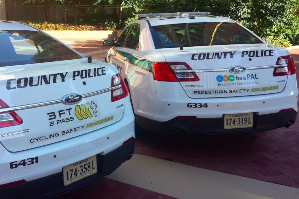 New decals on police cars remind drivers, pedestrians and cyclists to be Predictable, Alert, Lawful, or PAL (photo via Arlington County)