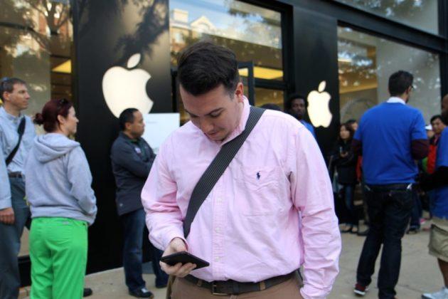 Kevin Rheinheimer, 24, scanned through his new iPhone 6 Sept. 19, 2014.