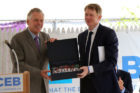 Gov. Terry McAuliffe presents a Virginia flag to CEB Chairman and CEO Tim Monahan