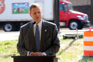 Del. Patrick Hope speaks at a ribbon-cutting for the new Route 50/N. Courthouse Road interchange