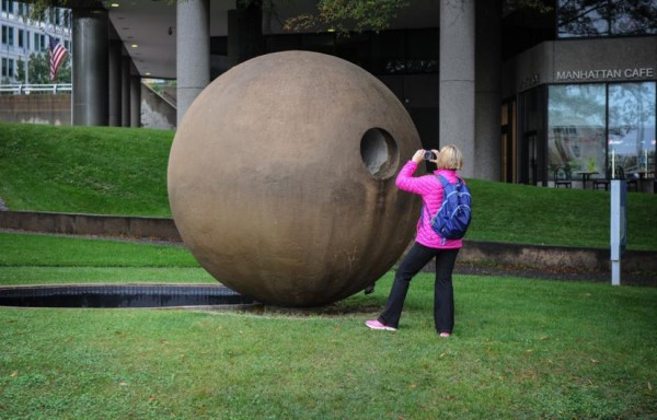 A woman photographs Dark Star Park in Rosslyn (Flickr pool photo by John Williams)