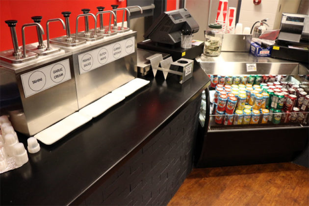 The sauces and drinks at Amsterdam Falafelshop in Clarendon